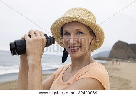 Woman at Beach Using Binoculars