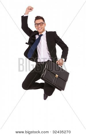Excited business man with briefcase jumping in mid-air cheering and celebrating his success