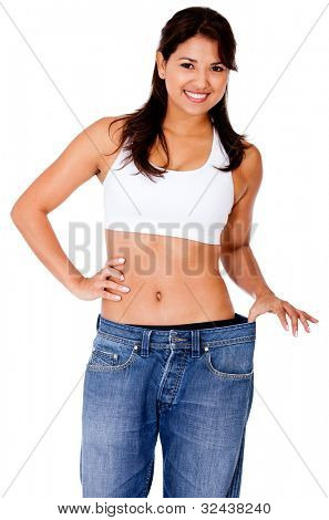 Woman in baggy clothes after loosing weight - isolated