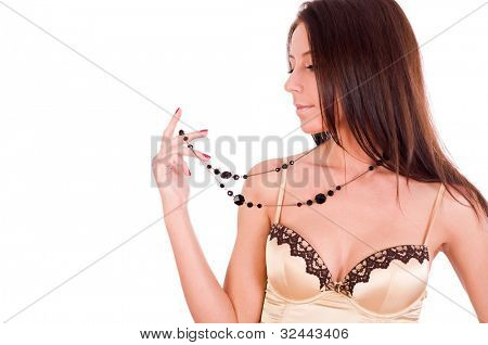 Woman wearing gold top and jewellery on white background