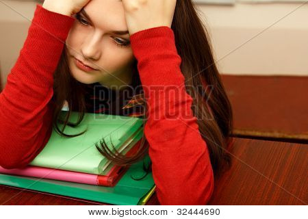 student teen girl beautiful tired in empty classroom university