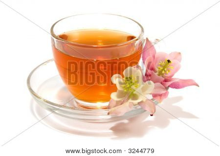 Transparent Teacup With Tea And Flowers