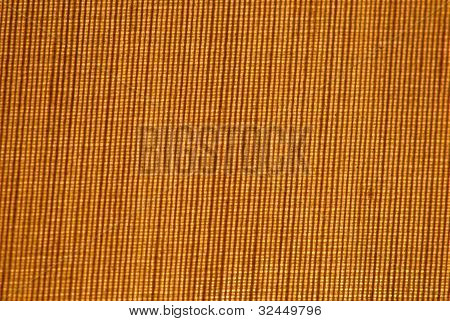closup of a cross weave background lite from behind