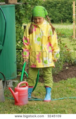 Little Girl Working In Garden