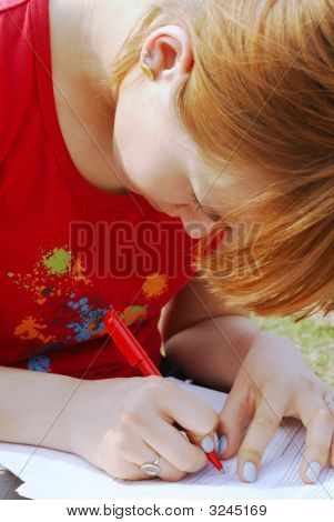 A Girl'S Writing On Her Knees