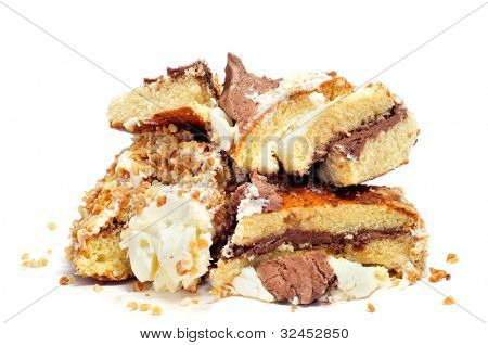 some leftover pieces of cake on a white background