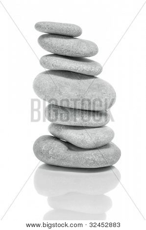 a pile of zen stones on a white background