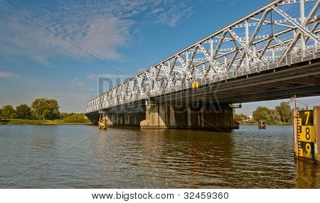 An Old Truss Bridge Over A Dutch River