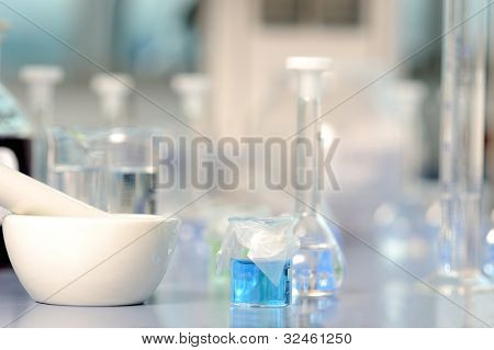 Lab flasks and grinding pestle