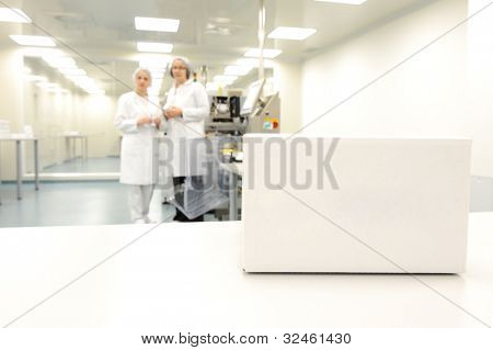 Crate in front of medical staff in modern factory