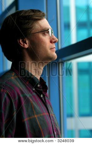 Man Standing By Window
