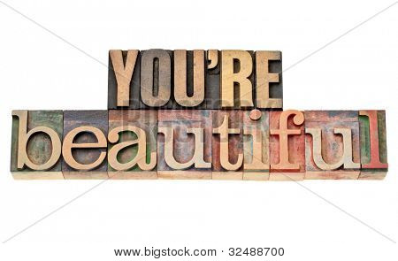 you are beautiful - affirmation words - isolated phrase in vintage letterpress wood type