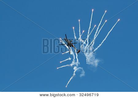 Apache AH-64D is shooting flares
