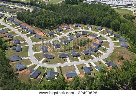 Aerial of suburban neighborhood culdesac homes in the eastern United States.