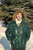 Winter Outfit. Man Unshaven Wear Warm Jacket With Fur Snowy Nature Background. Guy Wear Winter Jacke poster