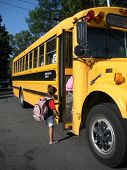 pic of school child  - A young child getting on the school bus - JPG