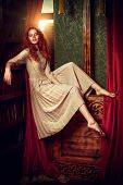 Beautiful romantic girl in a light lace dress in a vintage interior. Fairy tales. Young princess in  poster