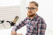 Radio Host Concept - Handsome Man Working As Radio Host At Radio Station poster