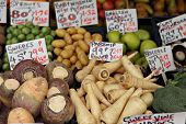 stock photo of rutabaga  - A display of late season vegetables on a fruit and veg stall in Great Yarmouth - JPG