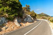Road Above The Sea On The Croatian Island Of Lastovo. Road Transport. Morning Sun On The Road By The poster