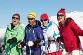 stock photo of portrait middle-aged man  - Group Of Middle Aged Couples On Ski Holiday In Mountains - JPG