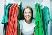 Happy Woman Shopper In White Dress Peeking Out Through Clothing With Green, Neo-mint, Coral Colors I poster