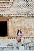 Young backpacker girl in Mayan ruins - Uxmal, Mexico