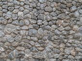 Stone Wall Background. Cobble Texture. Background Of Stone Wall Of Boulders And Pebbles. Texture Old poster