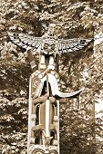 image of indian totem pole  - Totem poles are monumental sculptures carved from large trees - JPG