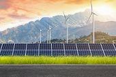 Asphalt Road With Solar Panels With Wind Turbines Against Mountanis Landscape Against Sunset Sky,alt poster