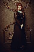 Historical reconstruction of the Victorian era. Portrait of an elegant woman in vintage  dress and h poster