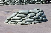 stock photo of sandbag  - Pile of sandbags filled and ready on the street - JPG