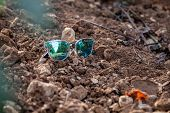 Closeup Beautiful Blue Green Mirrored Sunglasses Ultraviolet On Ground In Sunshine At Sunset, Reflec poster