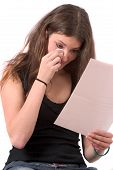 stock photo of saddening  - reading a bad news letter - JPG