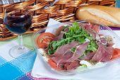 stock photo of nic  - Delicious salad with Parma ham arugula and mozzarella cheese - JPG
