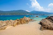 Sandy Beach With Rocks At Sunny Summer Day, Propriano Town. Coastal Landscape Of Corsica Island, Fra poster