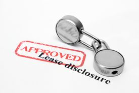 stock photo of rental agreement  - Close up of locks on Lease disclosure - JPG