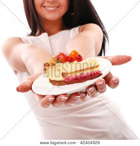 Piece of cake on a plate in woman hands