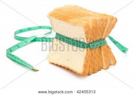 Bread Grasped By Measuring Tape