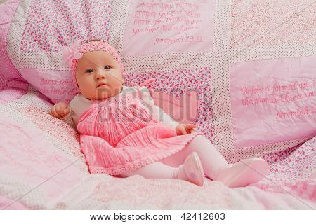 Baby Girl On Pink Blanket