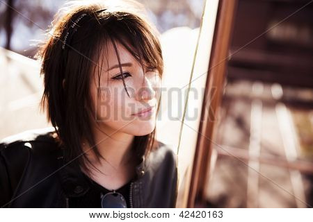Young beautiful woman staring at copy space.
