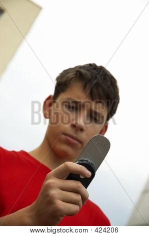 Teen With Cell Phone Outside