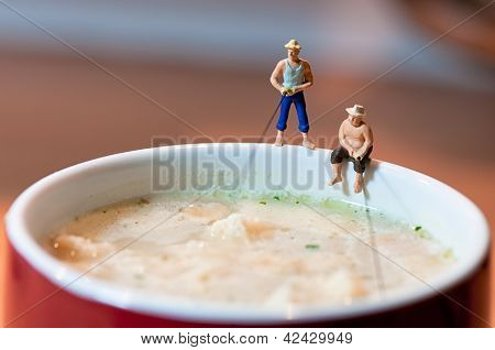Fishermen Fish In A Soup Mug