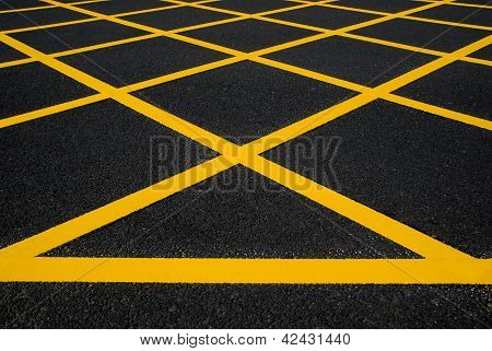 Cross Yellow Lines On Blacktop