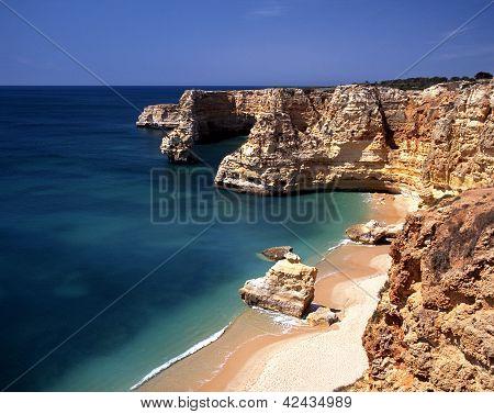 Rocky coastline, Praia da Marinha, Portugal.