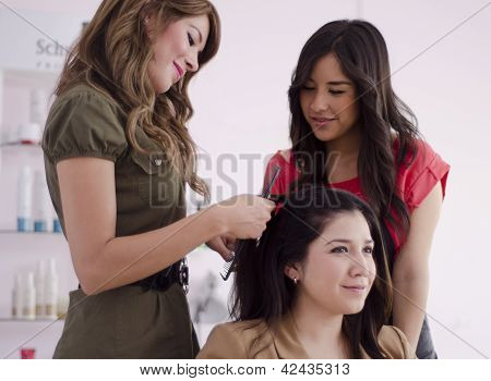 Hairstylist during training