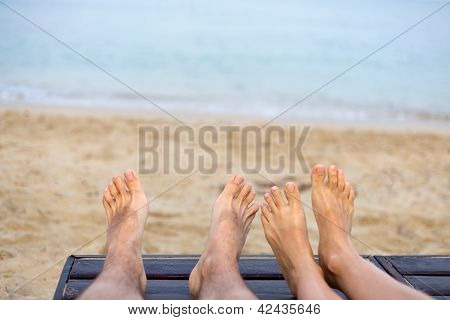 Feet Are On The Beach