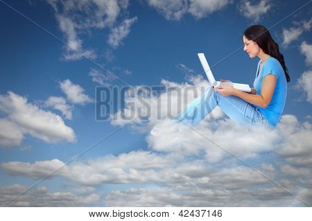 Young woman with laptop computer over conceptual background.