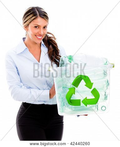 Happy woman recycling plastic bottles - isolated over a white background