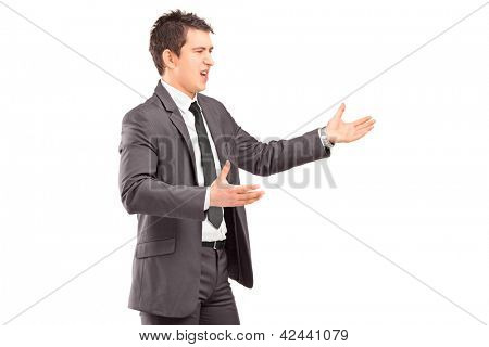 Young professional man in a suit arguing isolated on white background